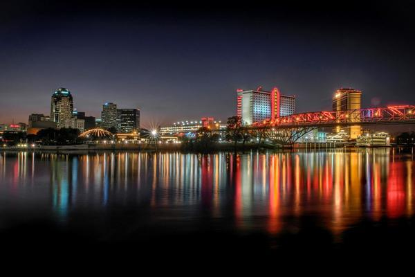 The lights of Shreveport, Louisiana reflecting off of the river at night