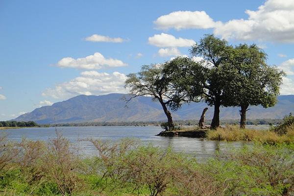 Zambian landscape of mountains, trees and a lake