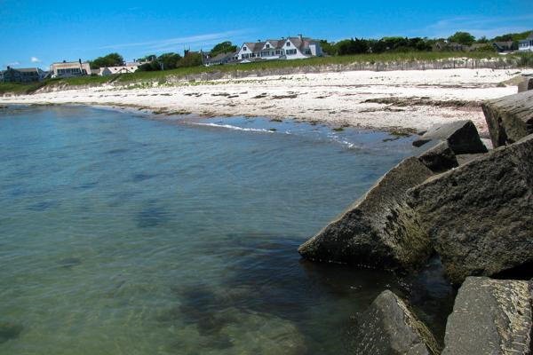 Blue waters crash against the shore before the Kennedy Compound in Hyannis, Massachusetts