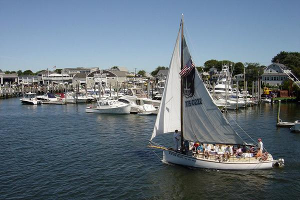 A boat sets sail with a full crew out of Hyannis, Massachusetts in Cape Cod