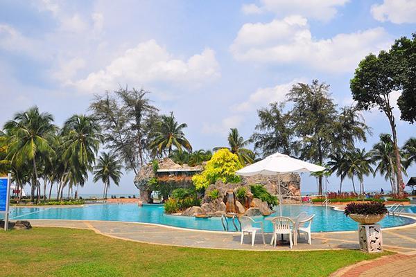The pool and palm trees of Cherating Beach Resort, Kuantan, Malaysia
