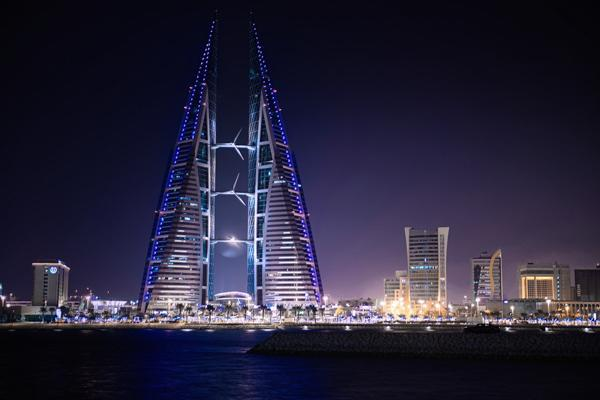 The World Trade Centre building lights up the night sky in Manama, Bahrain