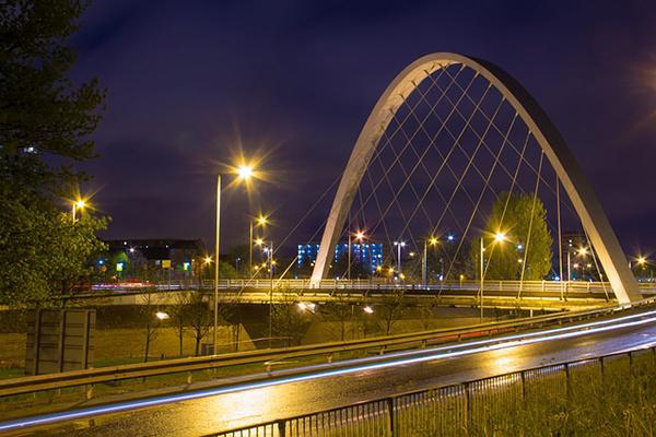 The Hulme Arch Bridge at night in Manchester, United Kingdom