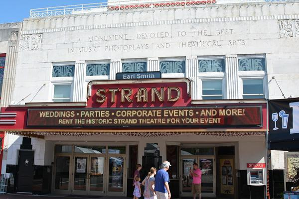 Patrons queue for an event at The Strand Theatre in Marietta, Georgia