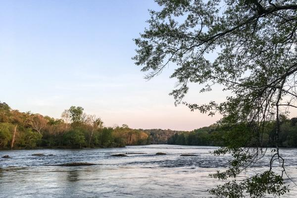Water flows steadily as the sun sets on the Chattahoochee River in Marietta, Georgia