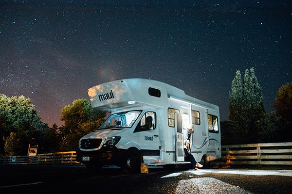 A Maui motorhome sits parked under the stars in New Zealand