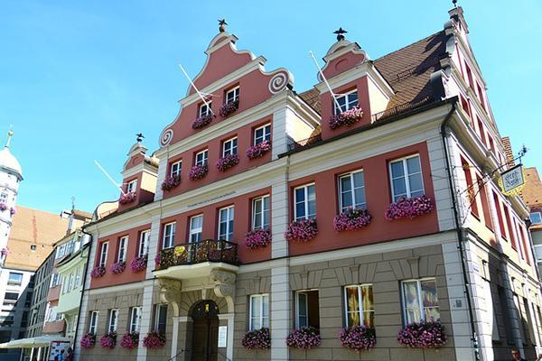 Flowers adorn the facade of a beautiful building in Memmingen, Germany