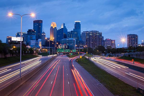 The city lights of Minneapolis, Minnesota shine brightly at dusk