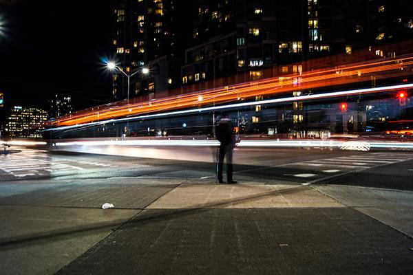 A traveller takes in the nighttime movements of Mississauga, Ontario