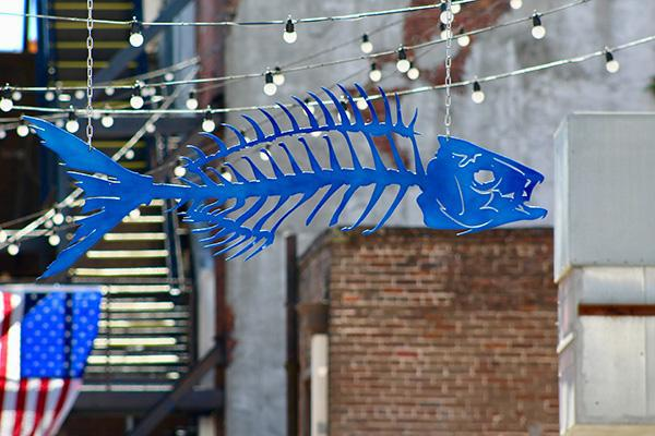 A fishbone alley sign leading to a funky area of dining and culture in Gulfport, Mississippi