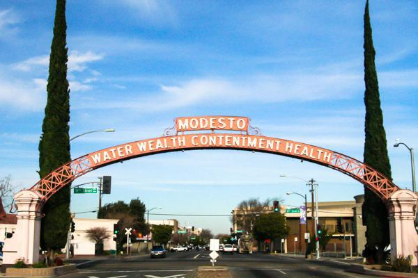 The iconic Modesto arch that says: Water Wealth Contentment Health