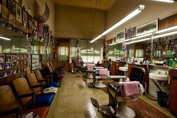 Empty seats await the first customers at a barber shop in Montgomery, Alabama