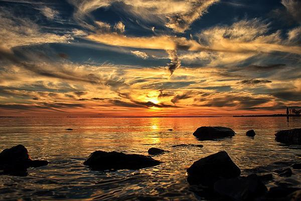 The clouds and setting sun paint the sky in beautiful colours in Dorval, Canada