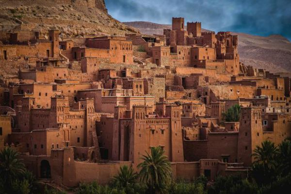 Ksar of Ait-Ben-Haddou, a group of earthen buildings surrounded by high walls, is a traditional pre-Saharan habitat in Morocco.