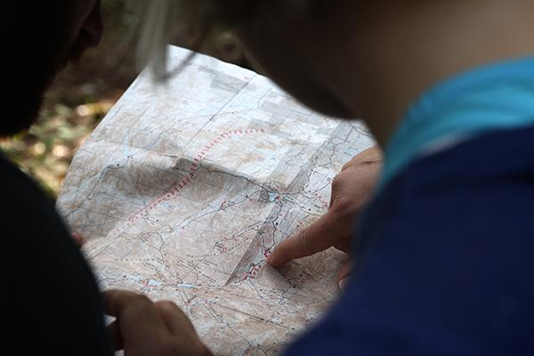 Two travellers studying a map