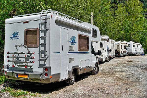 Several motorhomes parked tightly behind each other
