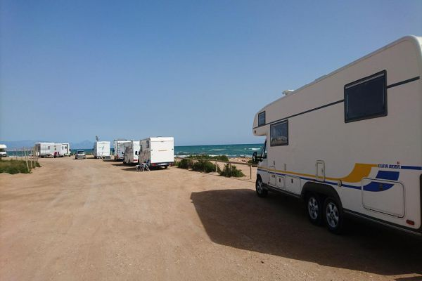 Various motorhomes parked seaside on a beautiful day