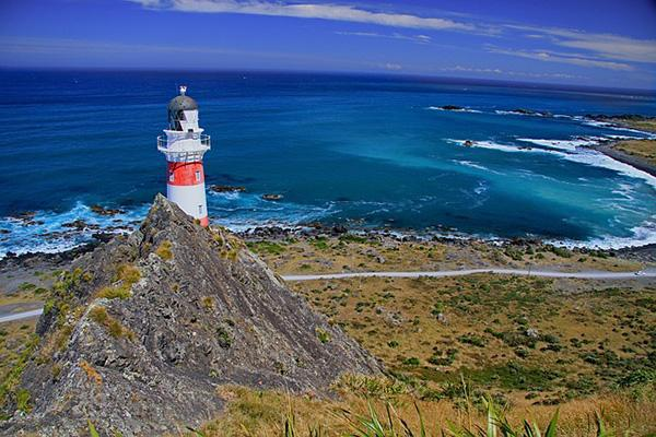 The Cape Palliser Lighthouse looks out to the coast on the southeastern tip of the North Island of New Zealand