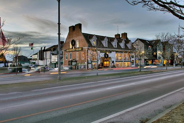 Lights of quaint buildings shine brightly at dusk in downtown Newport, Rhode Island