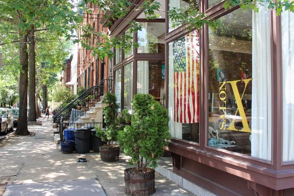 An American flag hangs in the storefront in downtown Jersey City, New Jersey
