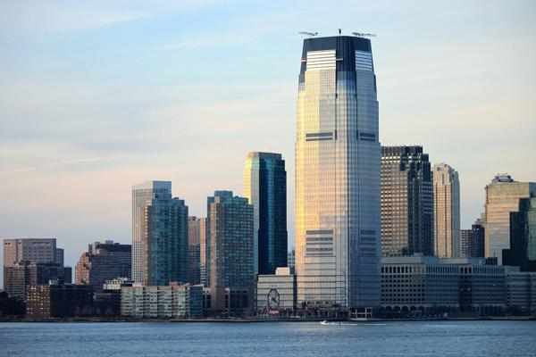The buildings of the Jersey City skyline stand proudly on the banks of the Hudson River