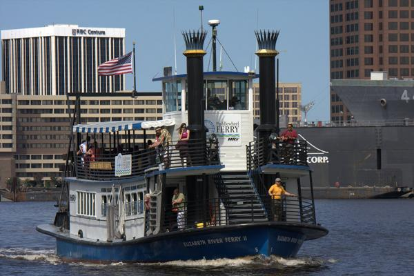 Passengers are transported around Norfolk harbor aboard a ferry in Virginia