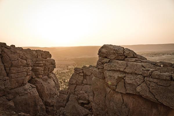 Rocky outposts overlook the landscape near Taghit, Algeria