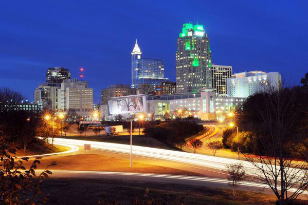 he city skyline of Raleigh by night.