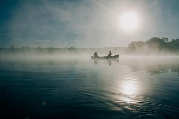 Two people fishing on a small boat in Ocala, Florida