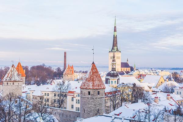 The beautiful buildings of Old Town of Tallinn covered in dusted snow in Estonia