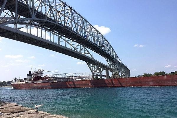 A giant freighter passes underneath the Blue Water Bridge in Sarnia, Ontario