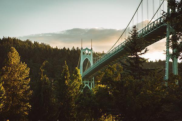 View of the St. Johns Bridge over lush greenery in Portland, Oregon