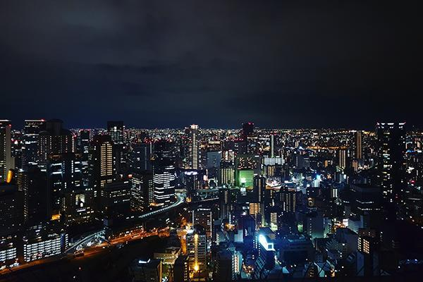 The neon lights and the crowded skyline of Osaka at night