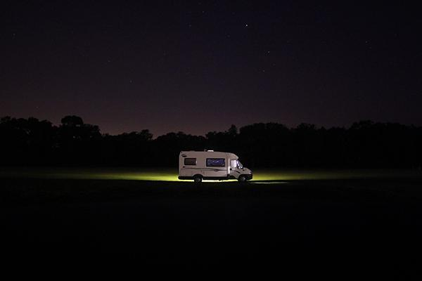 A motorhome parked up for the night under the stars