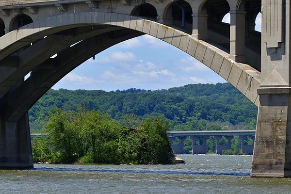 The Skerton Bridge over the River Lune with lush greenery in the background in Lancaster, Pennsylvania