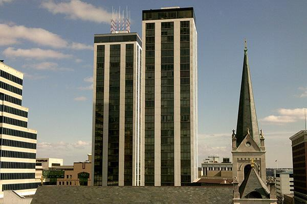 A pair of identical buildings stand tall in the middle of downtown Peoria, Illinois