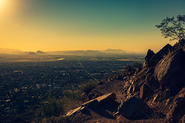 Orange washes over Phoenix, Arizona as the sun rises with a view from Camelback Mountain