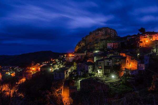 Residential lights illuminate the cliffs of Pietrapaola, Calabria