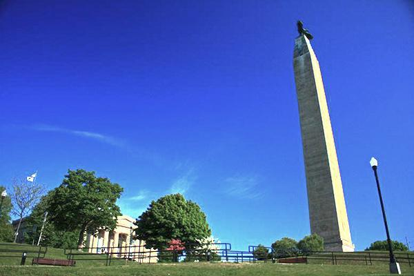 The Plattsburgh monument standing tall on a beautiful day in the state of New York