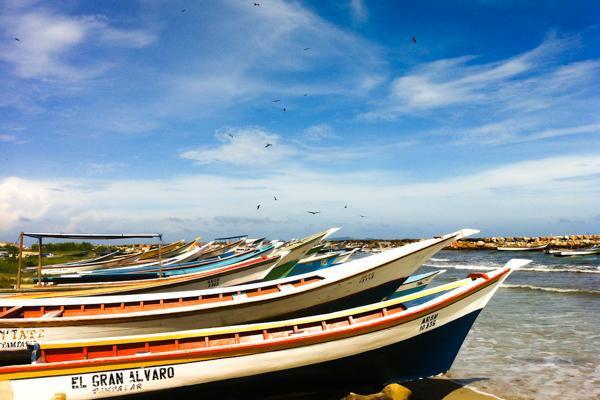 Fishing boats sit in the surf on Margarita Island near Porlamar