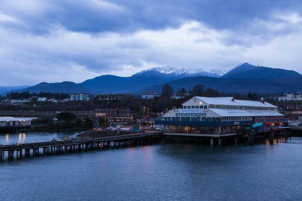 The Port Angeles Pier looking moody on a cloudy day in Port Angeles, Washington