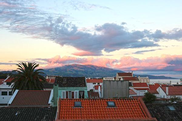 A rooftop view of Ponta Delgada coast at sunset on Sao Miguel Island, Portugal (Azores)