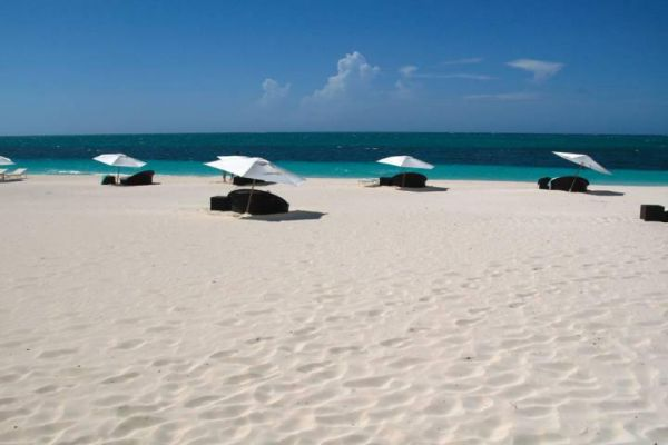 Become inspired to travel to Providenciales to see the white sand beaches.