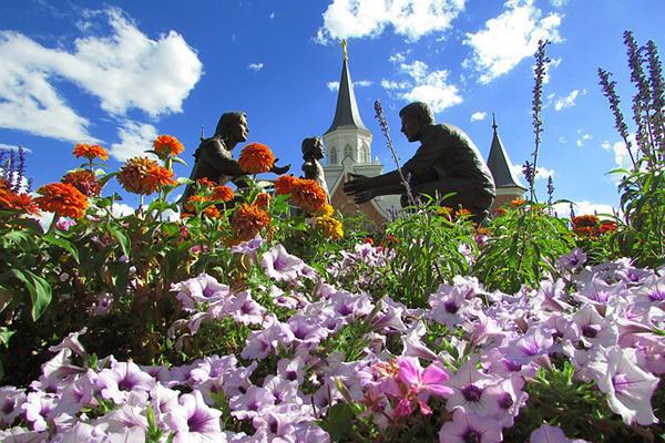 Beautiful flowers surround a religious monument in Provo, Utah