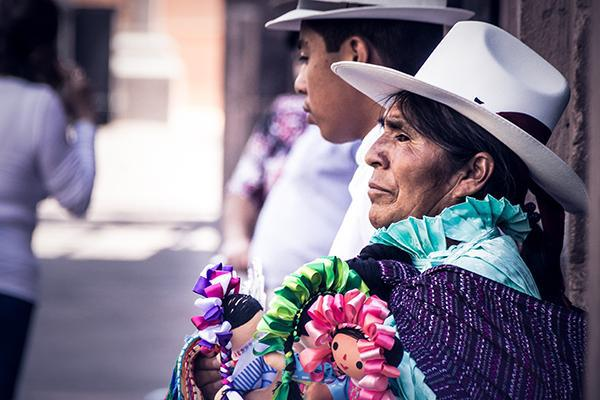 Residents of Queretaro, Mexico talking on the street