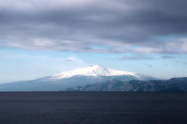 View of snow-capped Mount Etna from Reggio Calabria, Sicily, Italy