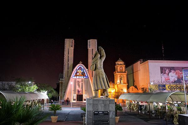 A statue stands over a religious site in Reynosa, Texas