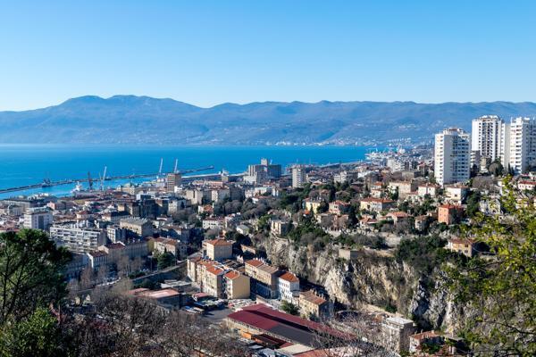 The city of Rijeka, Croatia overlooks the blue waters of the Adriatic Sea