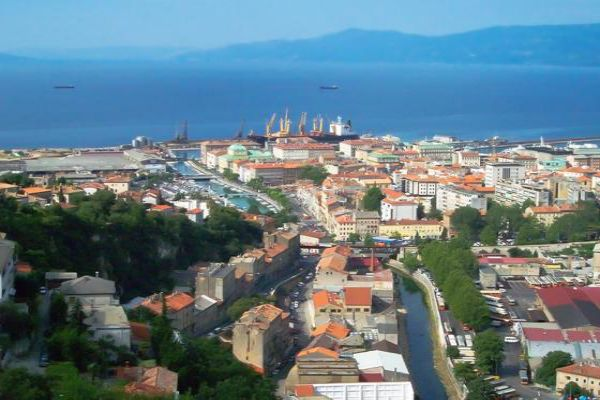 A ship sits in the harbour of the colourful city of Rijeka, Croatia