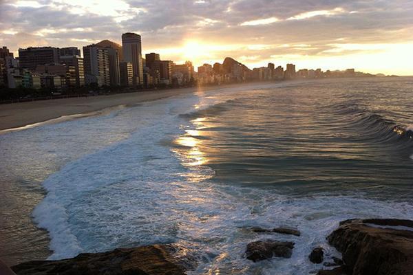 The sun sets over Copacabana Beach in Rio de Janeiro, Brazil